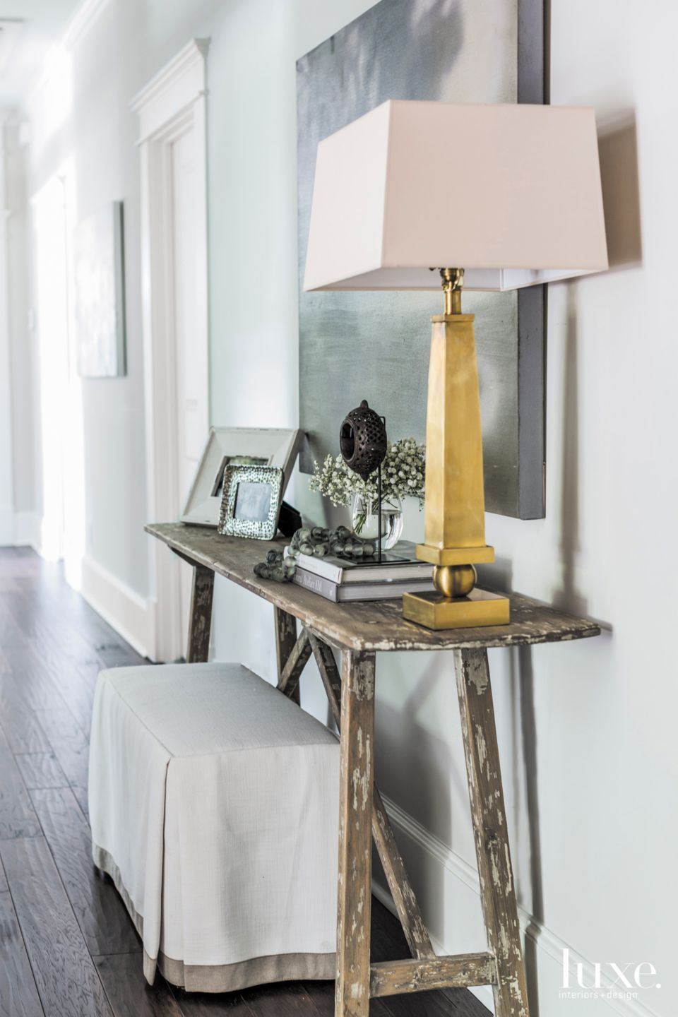 Eclectic White Foyer with Rustic Wood Console