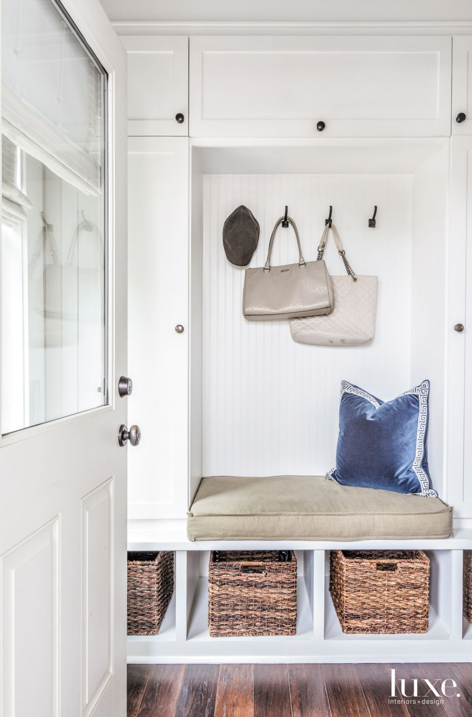 Eclectic White Mudroom with Built-In Bench