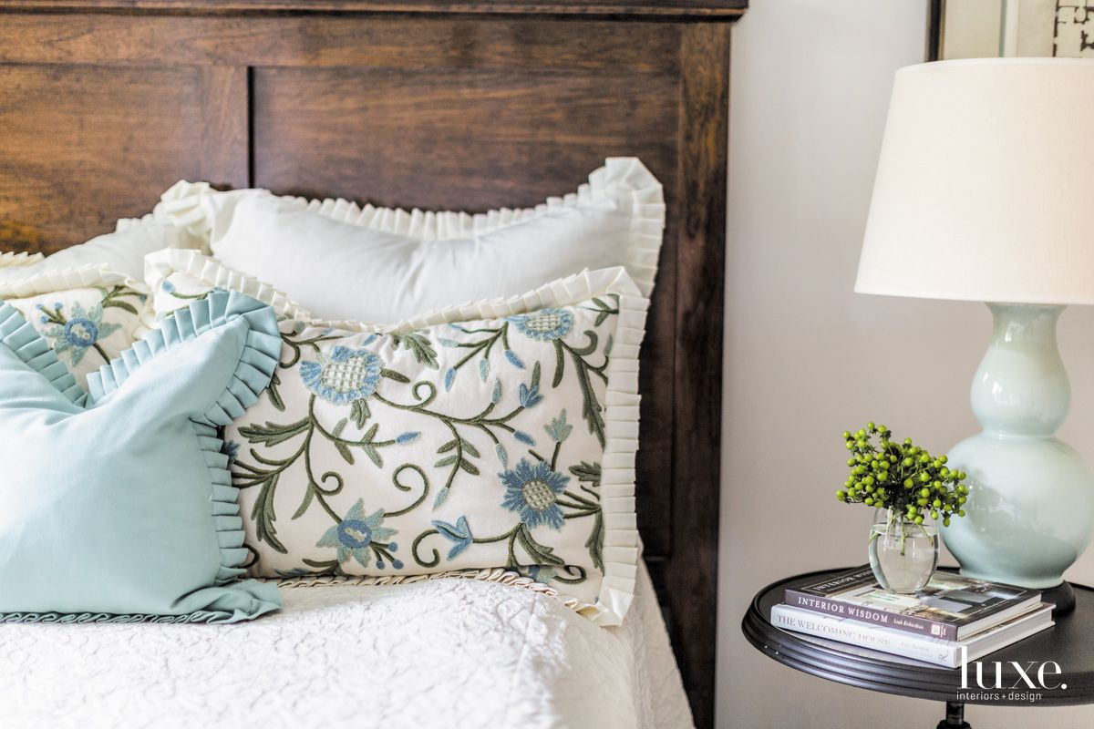 Eclectic White Guest Bedroom with Embroidered Pillows