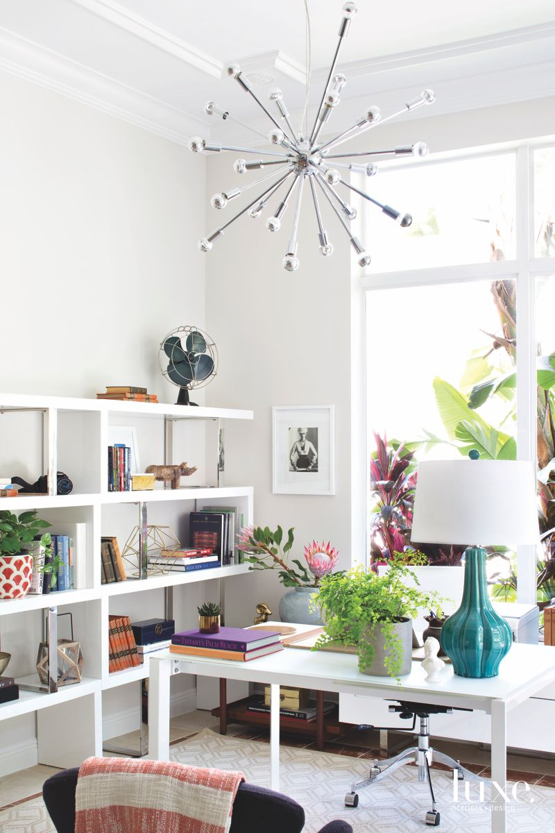 White Light Office with Chandelier and Lots of Shelving