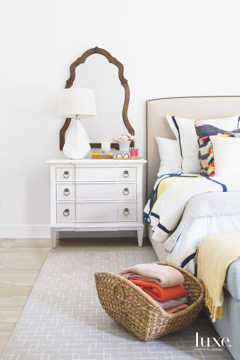 Master Bedroom Vignette with Traditional Mirror and Colorful Bedding