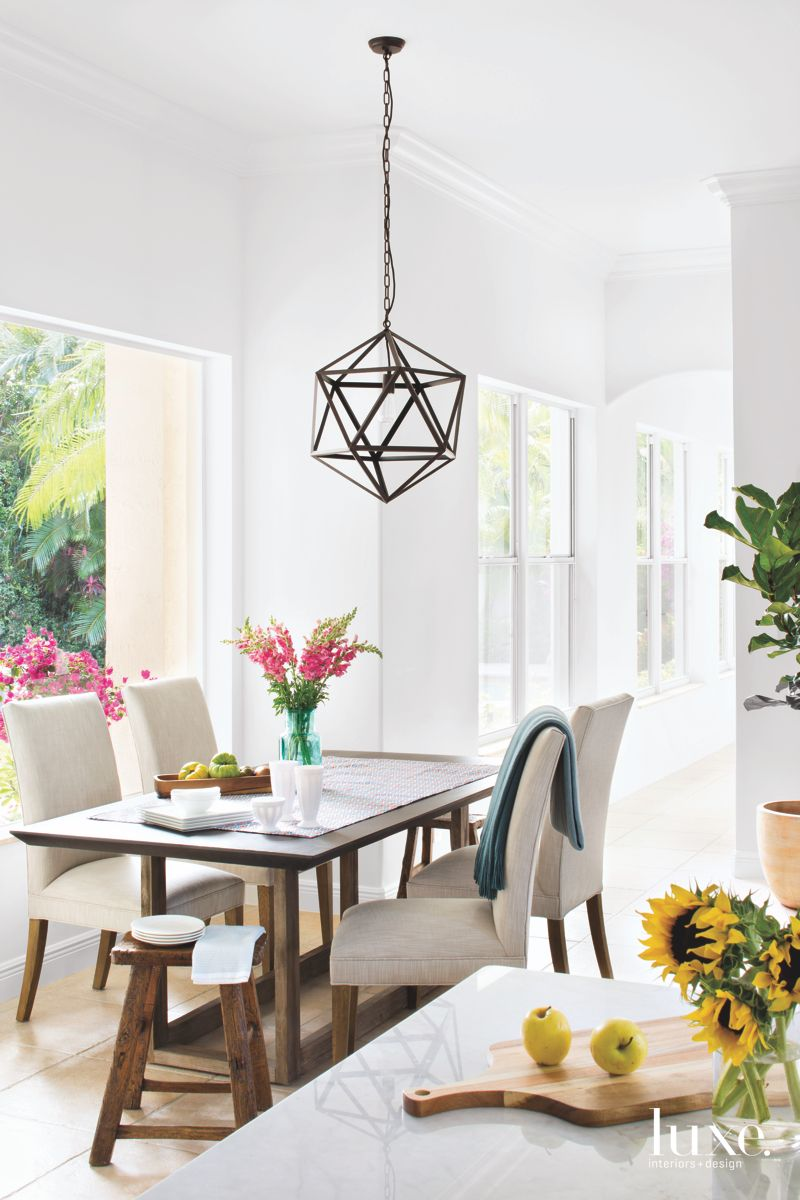 Informal Dining Room with Hanging Chandelier Pendant and Flowers
