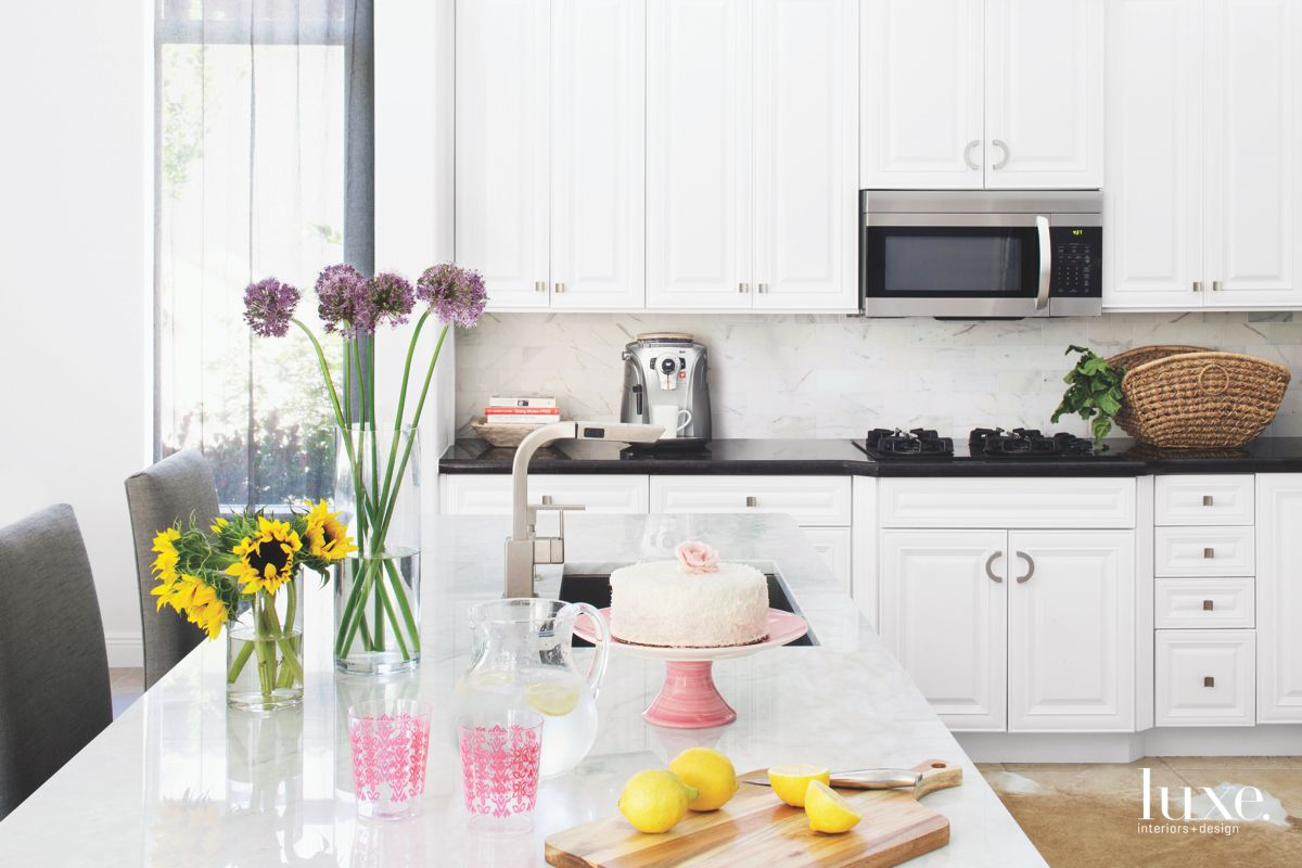 Charming White Country Kitchen with Black Countertops