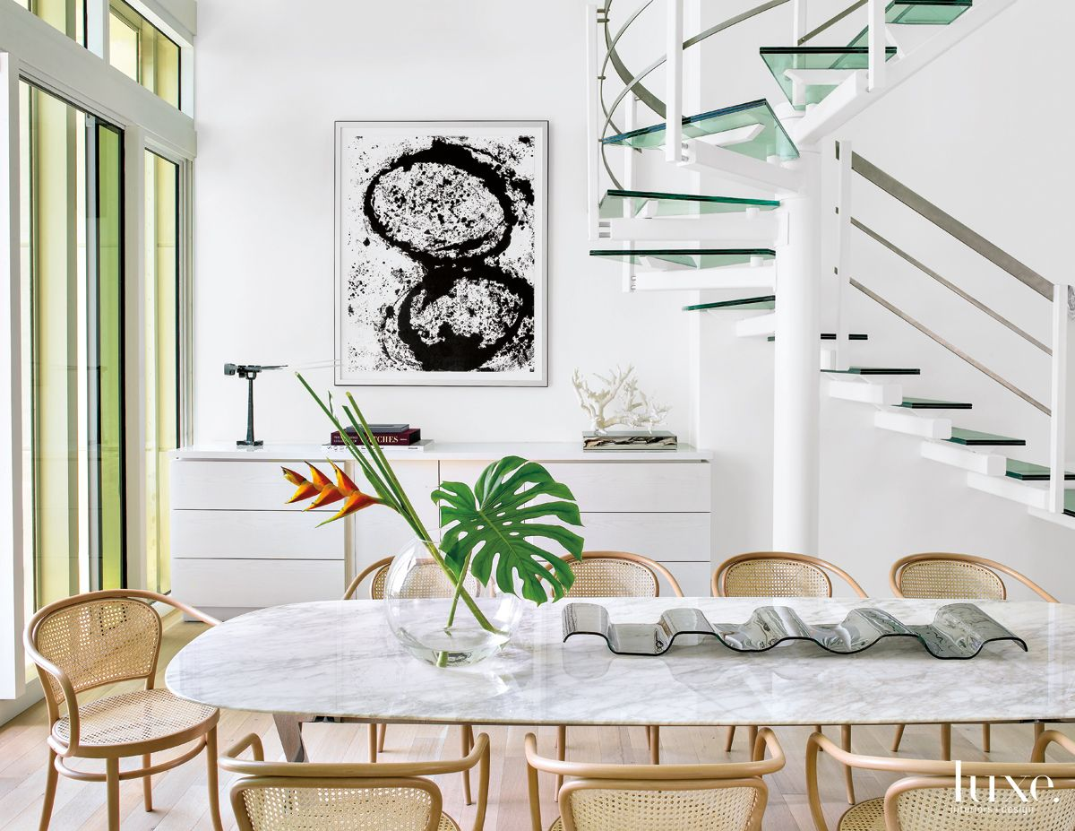 Modern White Dining Area With Basket Weave Chairs Luxe Interiors Design