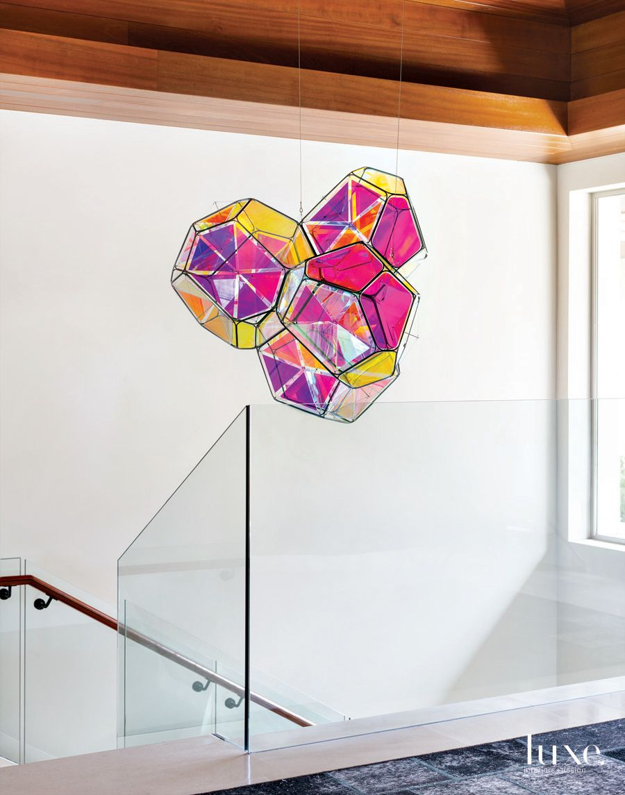 Contemporary White Staircase with Hanging Sculpture