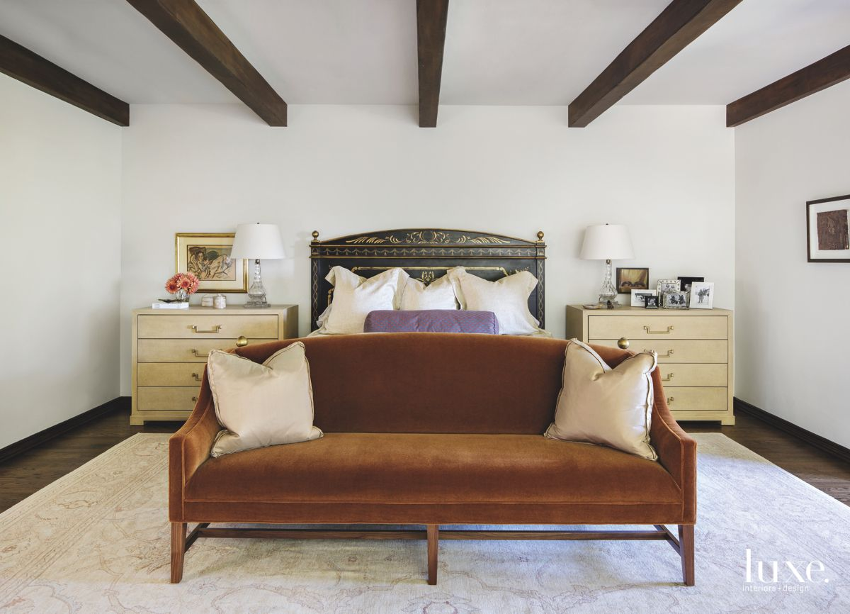 Wooden Beam Ceiling Master Bedroom with Velvet Bench and Metal Backboard