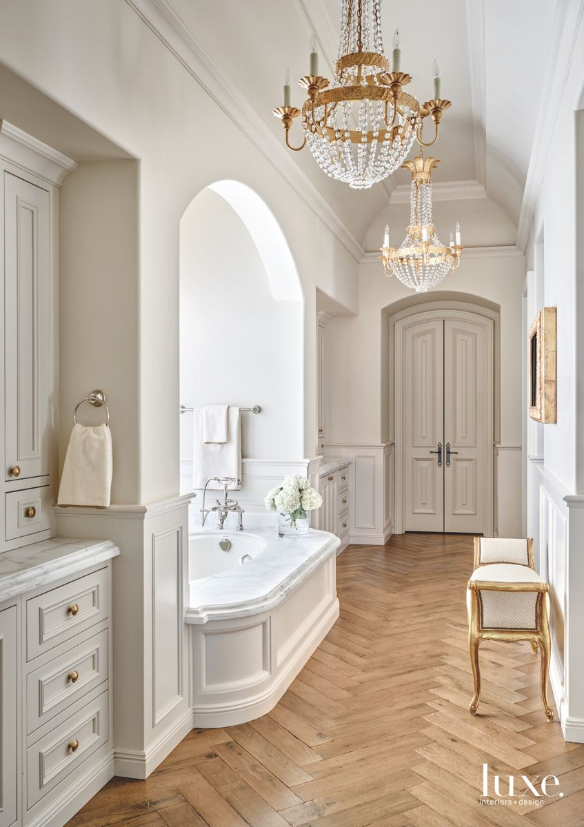 Chevron Herringbone Master Bathroom with Two Crystal Chandeliers and Bench
