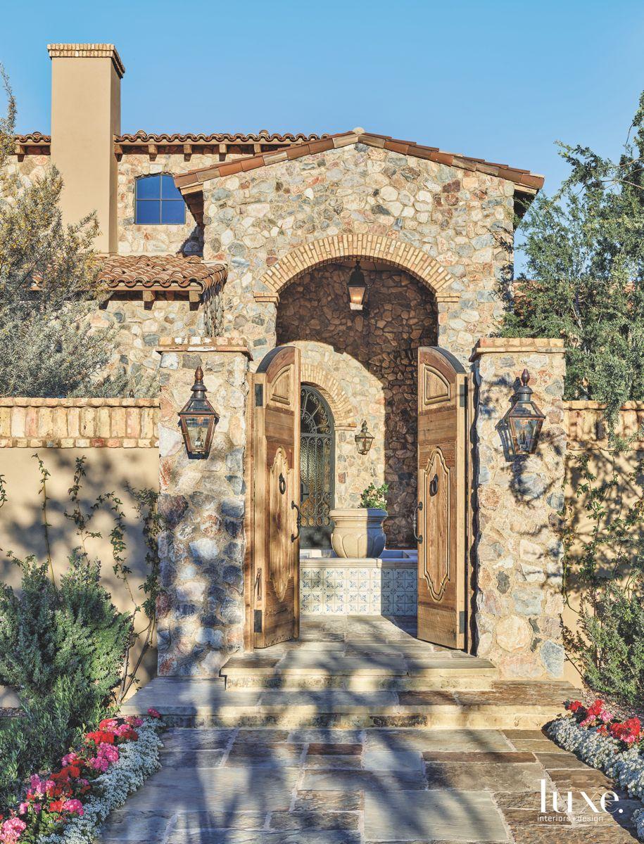 Neutral Stone and Stucco Exterior Arizona Home Entrance Walkway