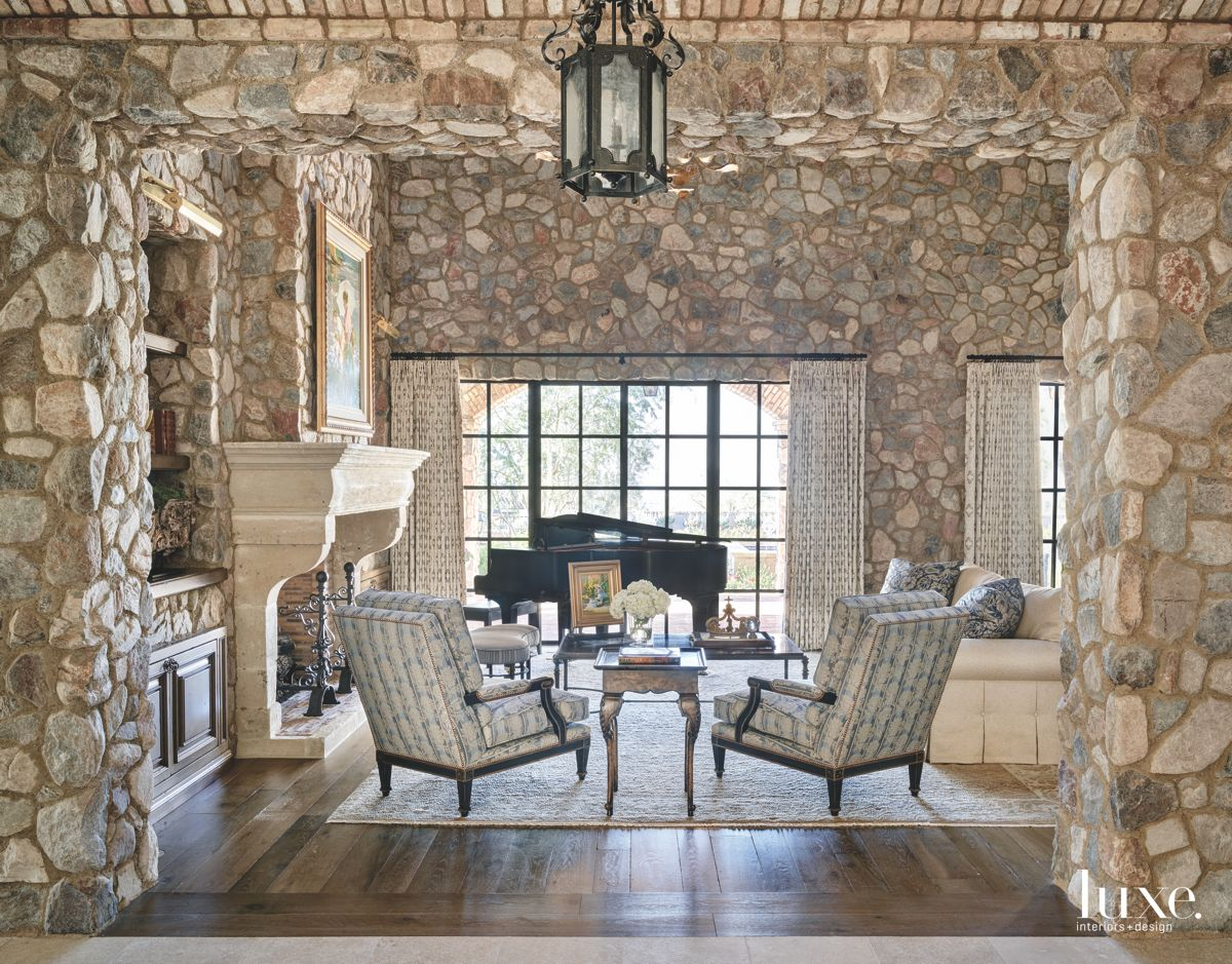 Stone Enveloped Great Room with Lantern Lights Fireplace Piano and Seating