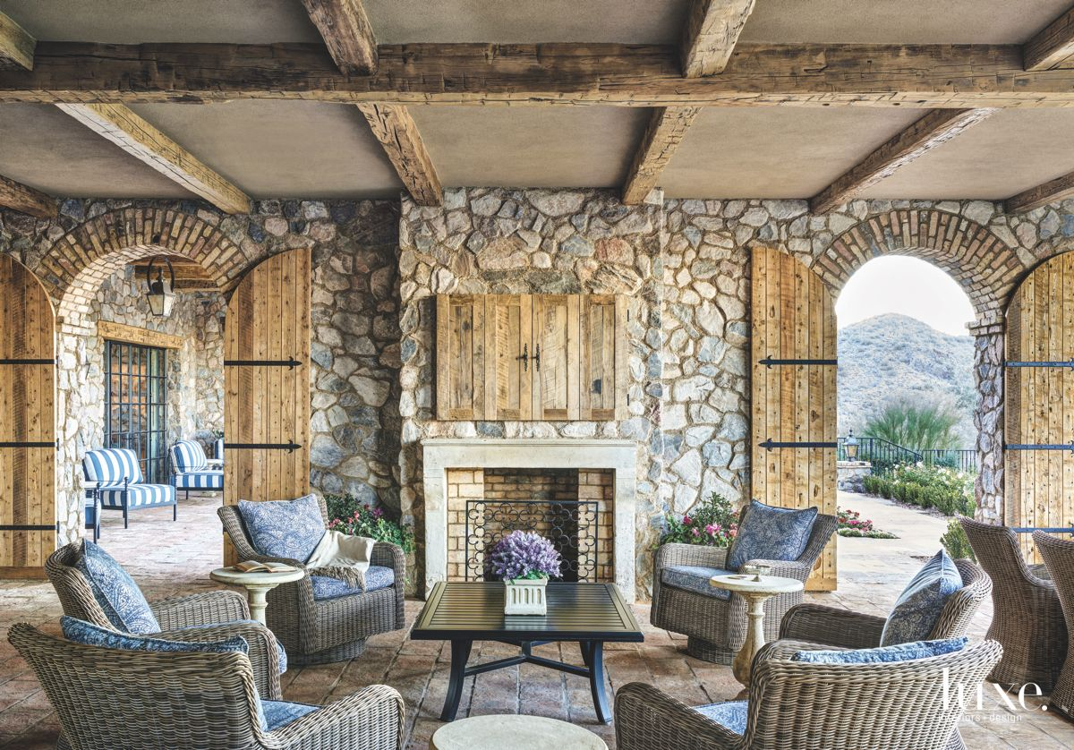 Reclaimed Wood Outdoor Room Ceiling with Wicker Outdoor Furniture and Fireplace