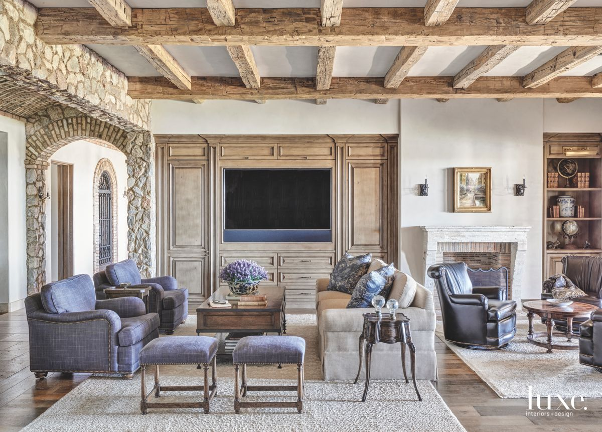 Coffered Reclaimed Wood Ceiling Family Room with Blue Furniture Fireplace and Television