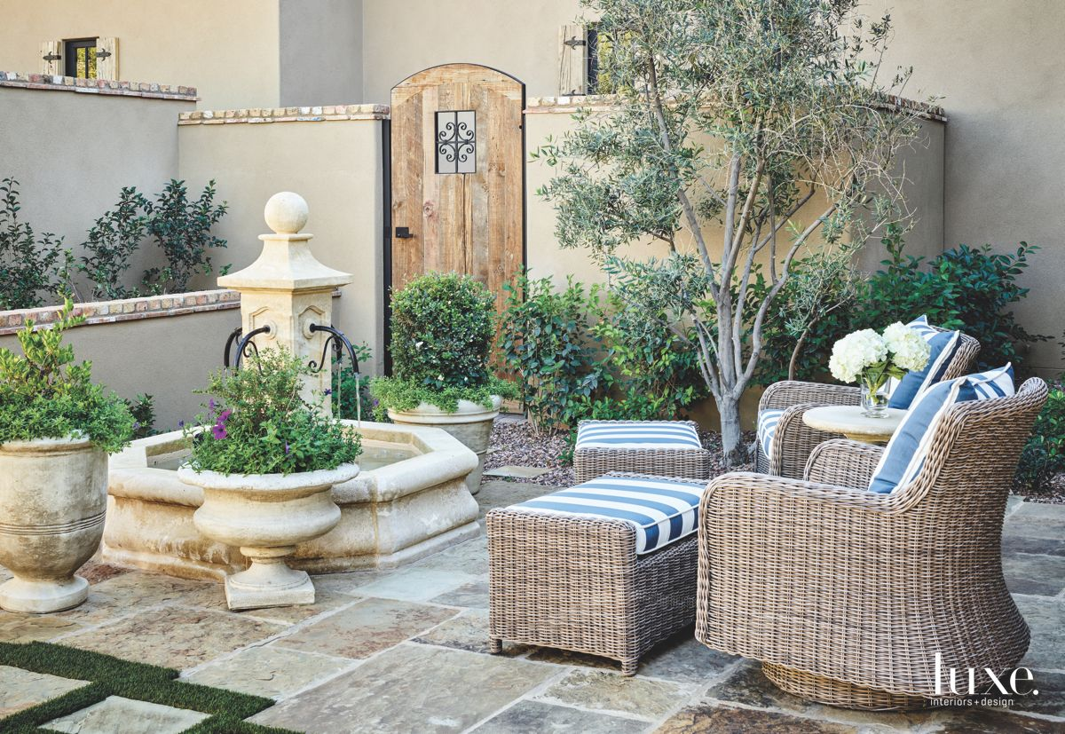 Traditional European Feel Courtyard with Fountain and Wicker Furniture