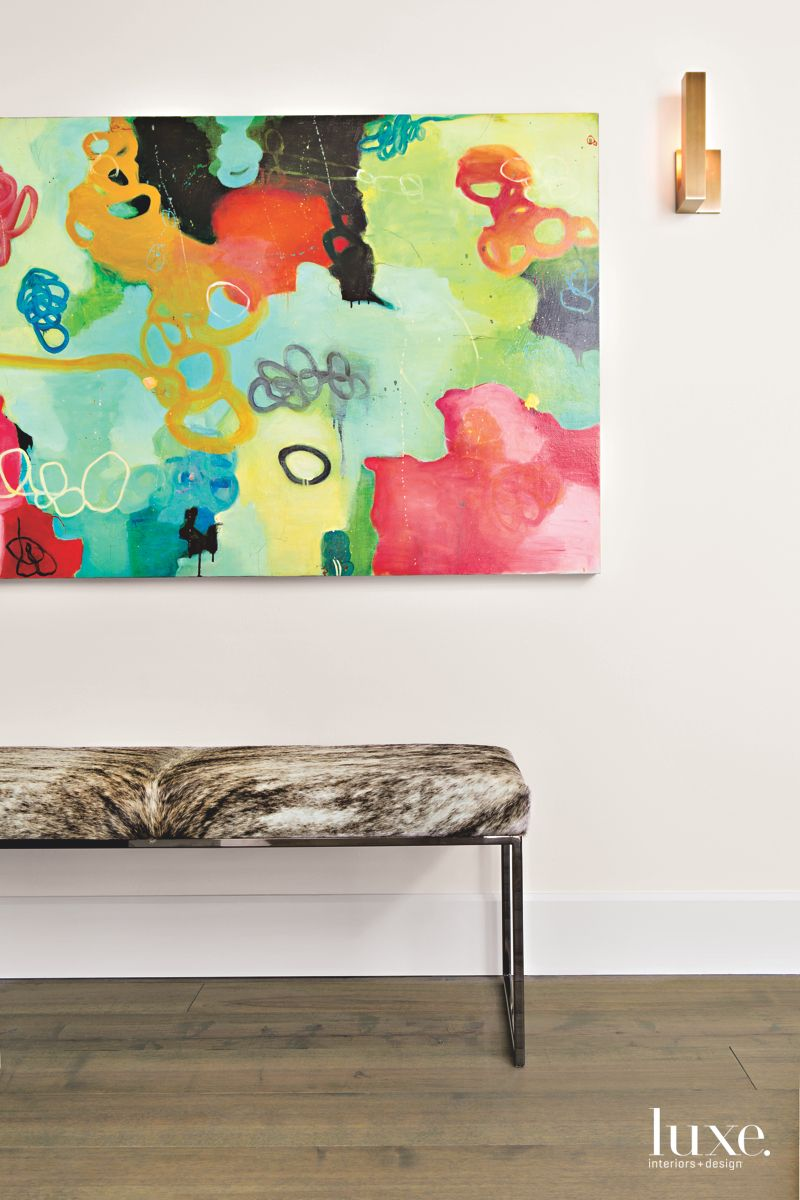 Vibrant Abstract Art and Bench with Sconces