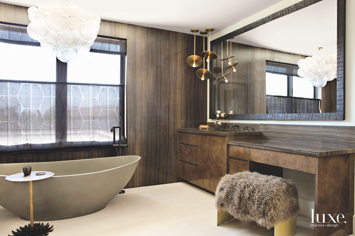 Brown Master Bathroom with Chandelier and Fur Throw