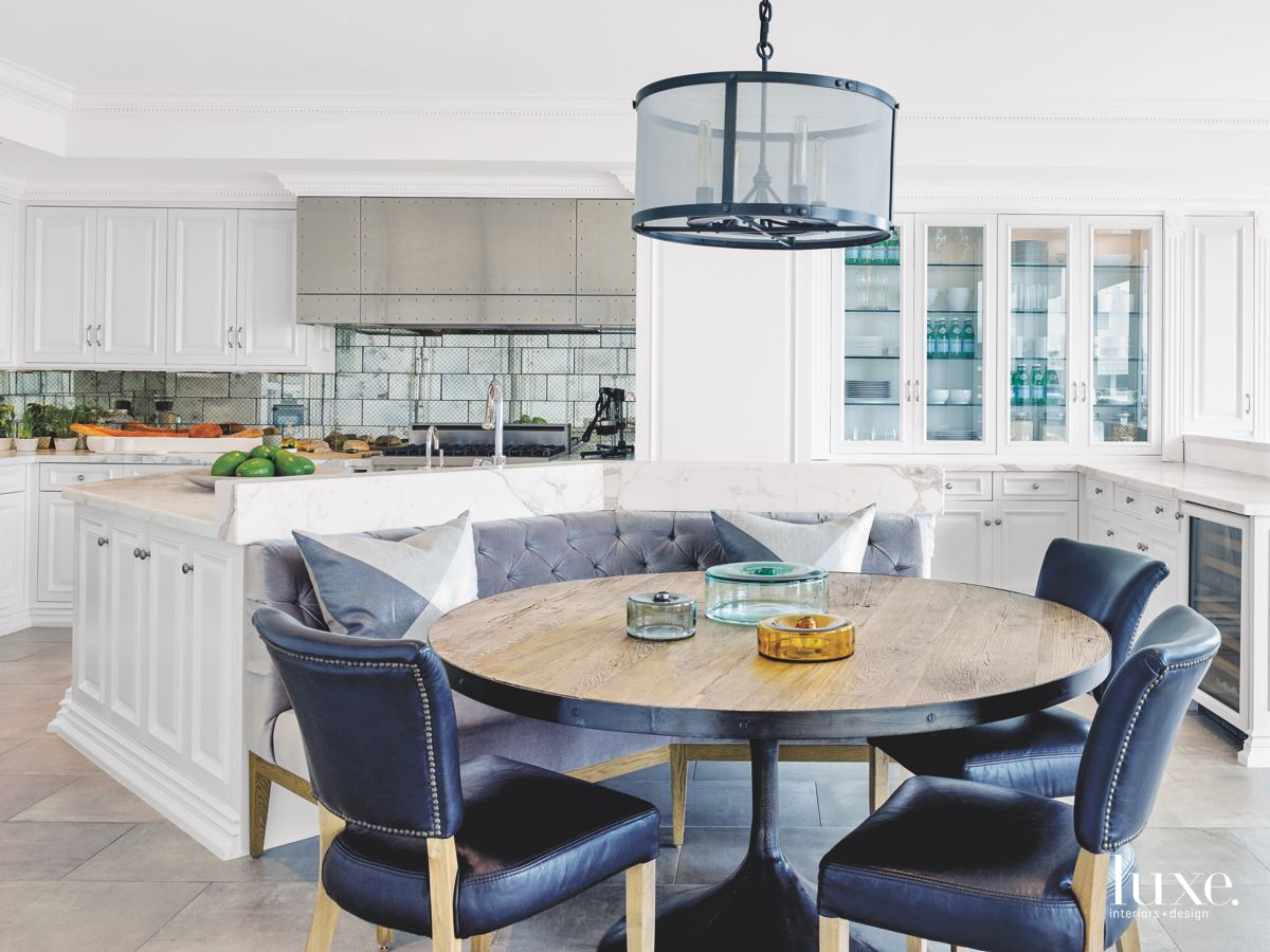 Kitchen with Porcelain Tiles and Blue Furniture Accents