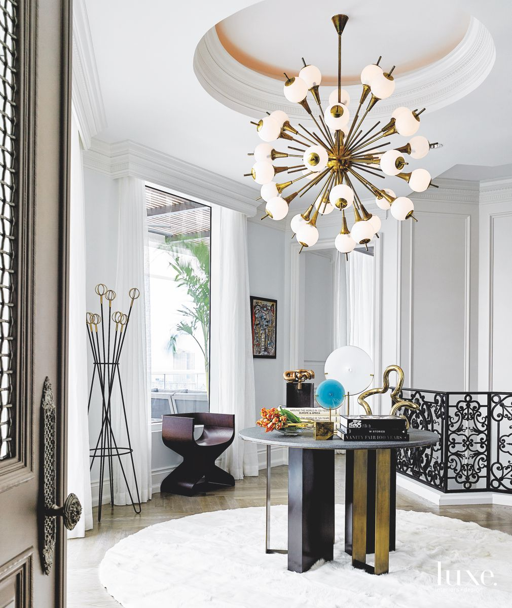 Standout White Chandelier on the Stair Landing
