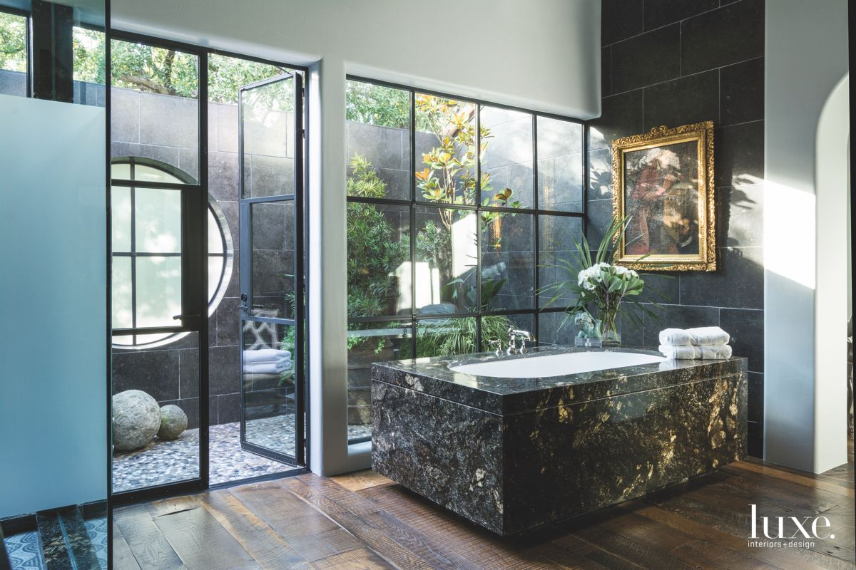 Japanese Teahouse Master Bathroom with Zen Aesthetic and Black Marble Features
