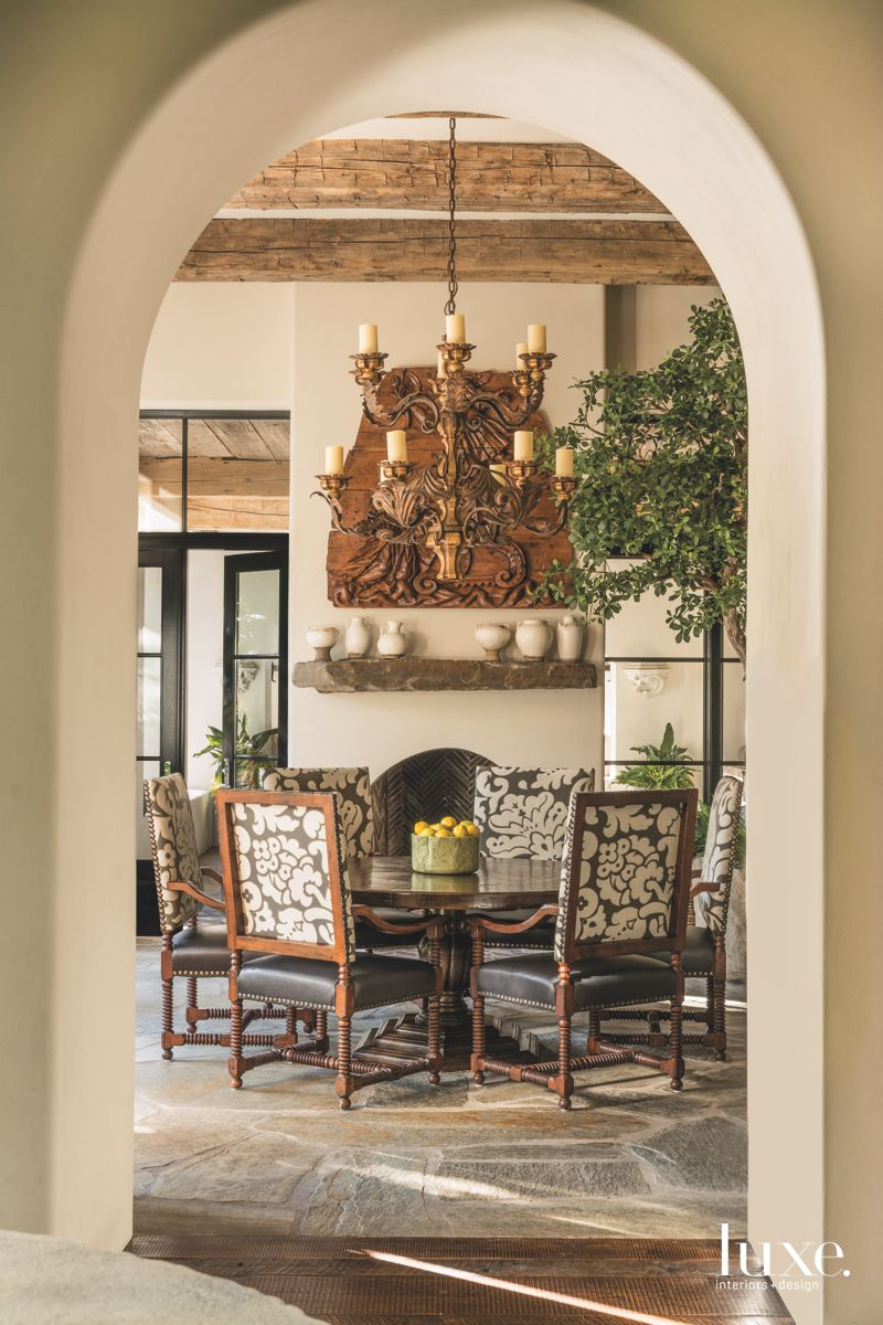 Door Arch with Breakfast Room View of Dining Table, Chandelier, and Fireplace