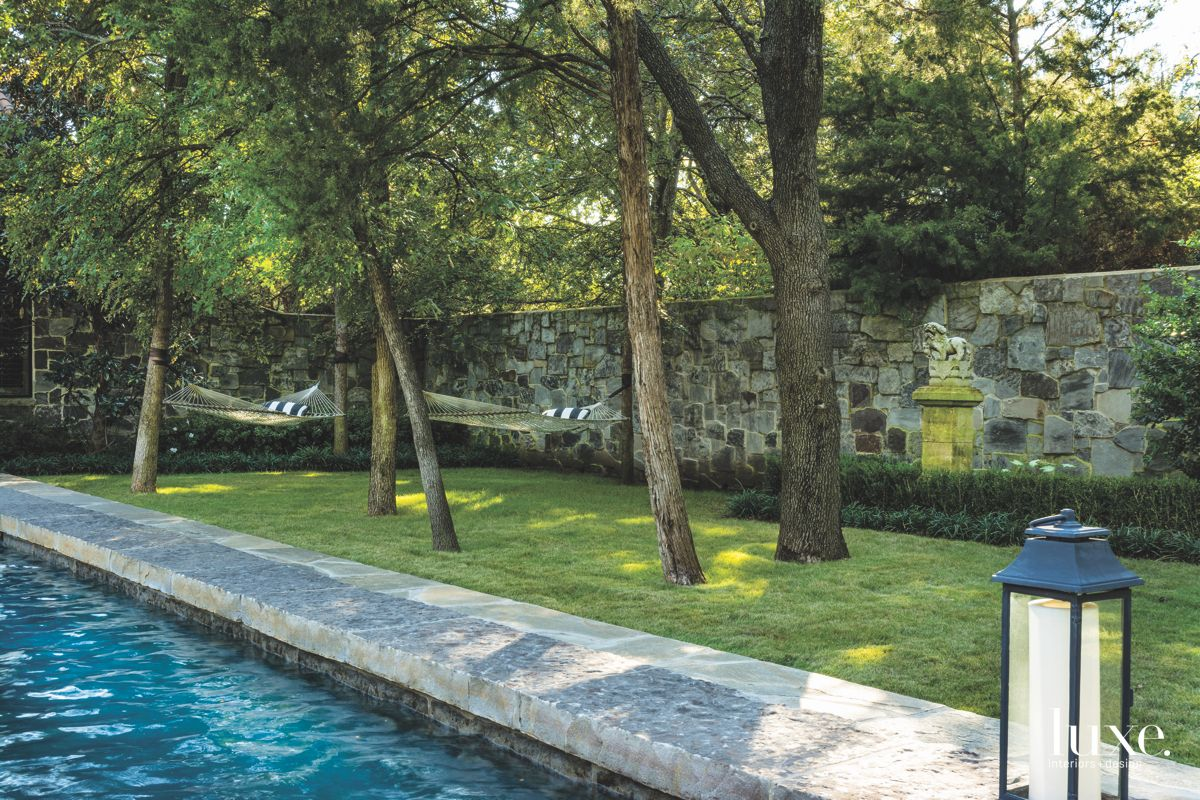 Poolside Hammocks Under Existing Elm Trees with Stone Wall