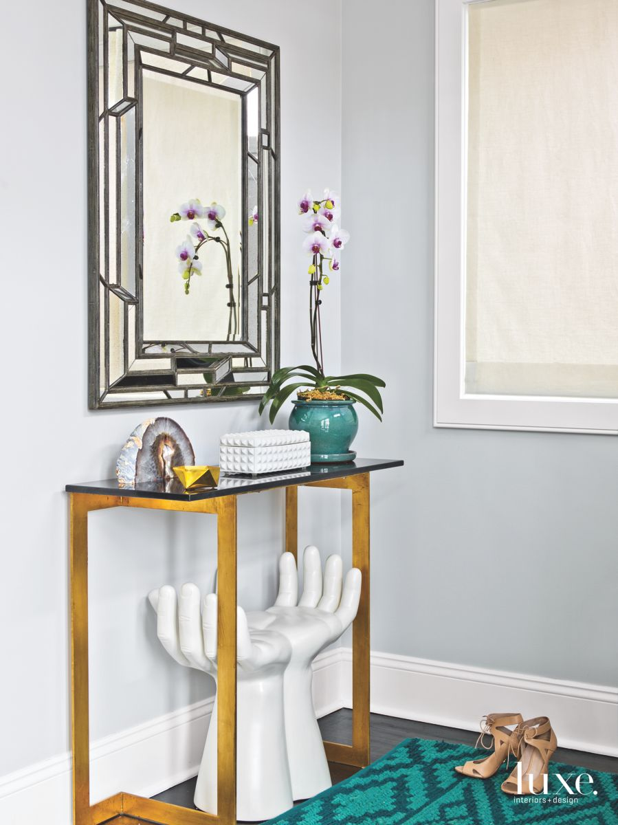 Hand Sculpture Stool Neutral White Entryway with Mirror and Flowers