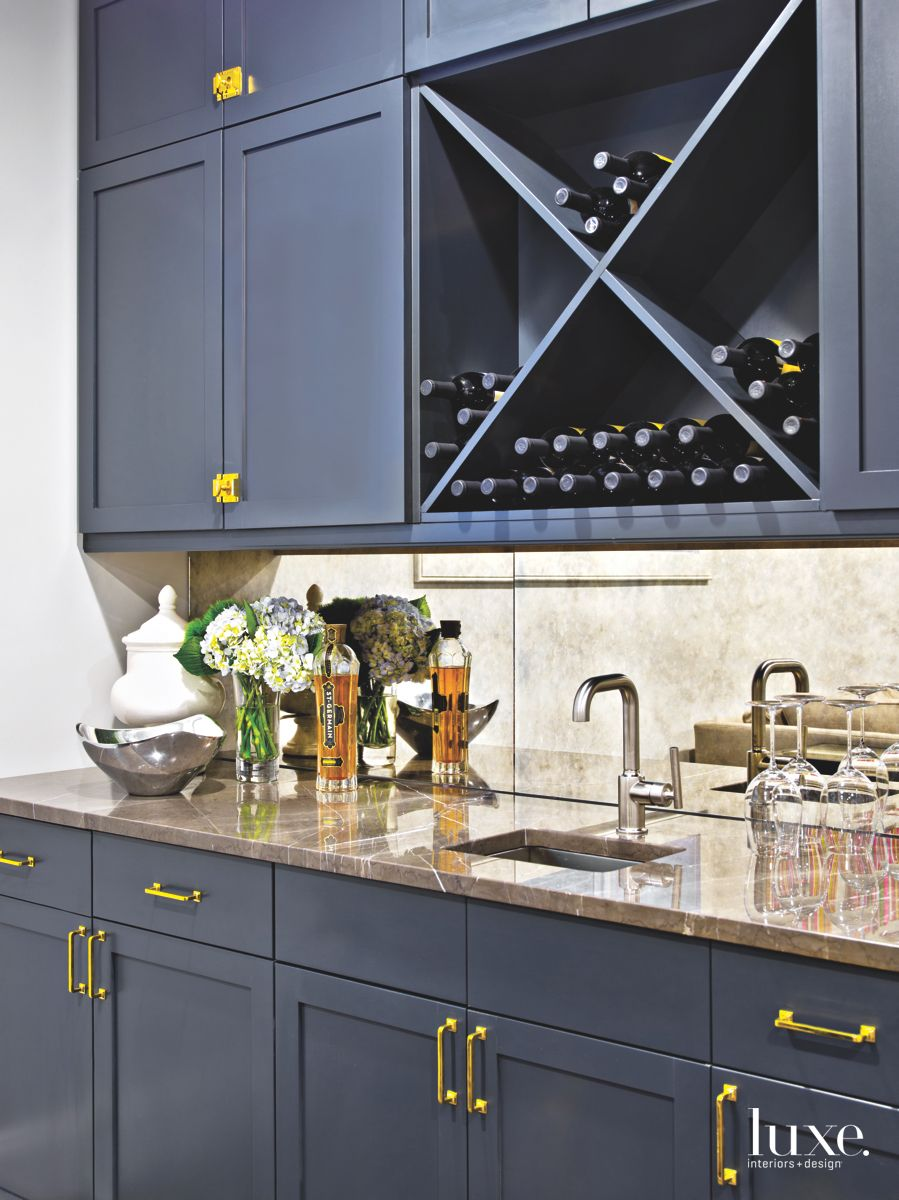 Dark Blue Basement Wet Bar with Mirror Backsplash