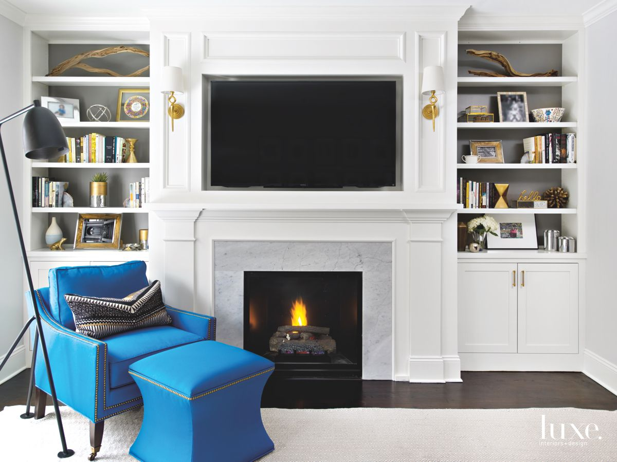 Built-In Millwork Family Room with Blue Chair, Ottoman, Television and Fireplace