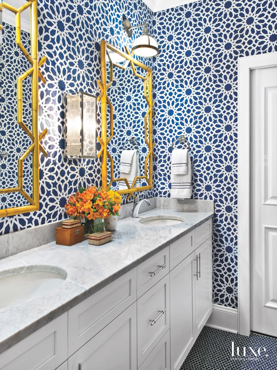 Flower Patterned Jack and Jill Bathroom with Mirrors