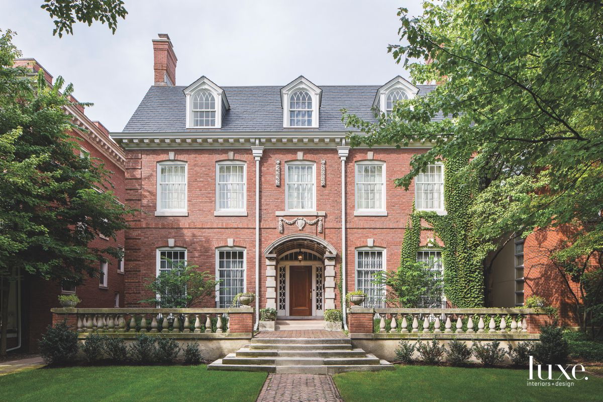 Traditional Architecture Brick Exterior with Terrace and Lawn and Tile Walkway