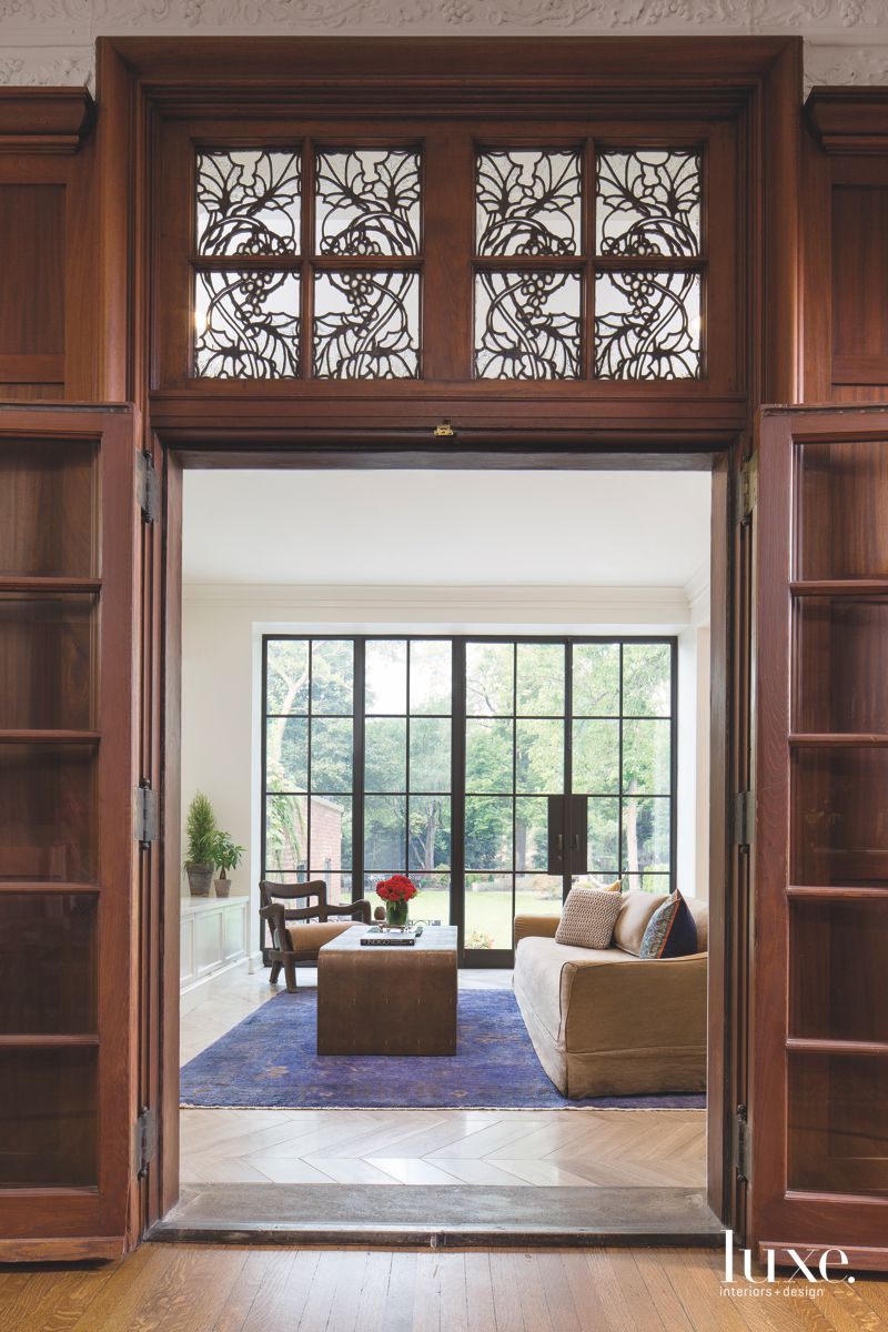 Glass Wall Windows with Neutral Furniture and Rich Blue Rug