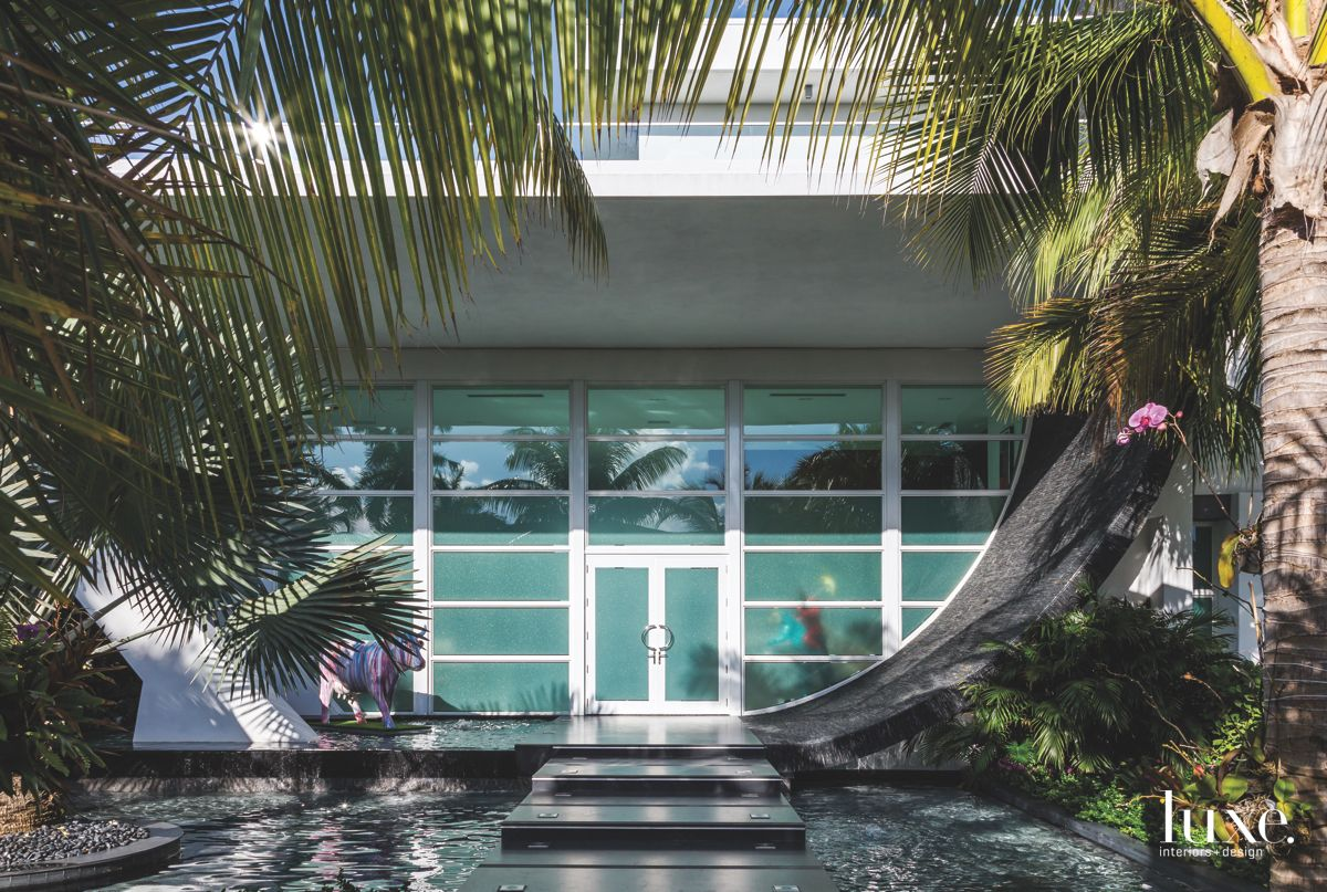 Curved Water Entrance Surrounded by Palm Trees