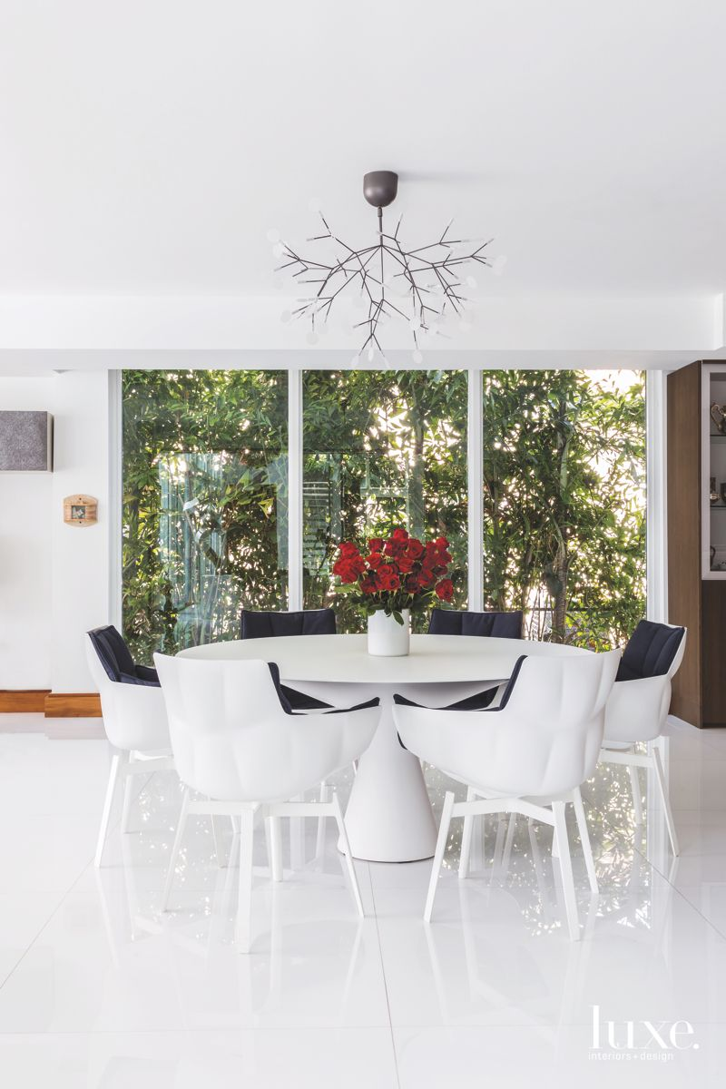 Branch Chandelier White Dining Room with Large Windows