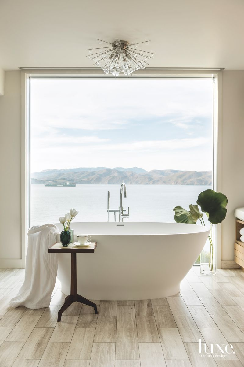 Freestanding Soaking Tub Master Bathroom with Pacific Water Views and Leaf