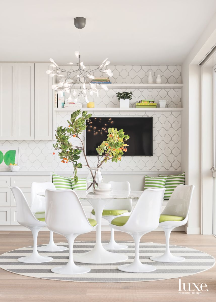 Green Stripe Pillow and Rug White Breakfast Area with Television and Abstract Chandelier