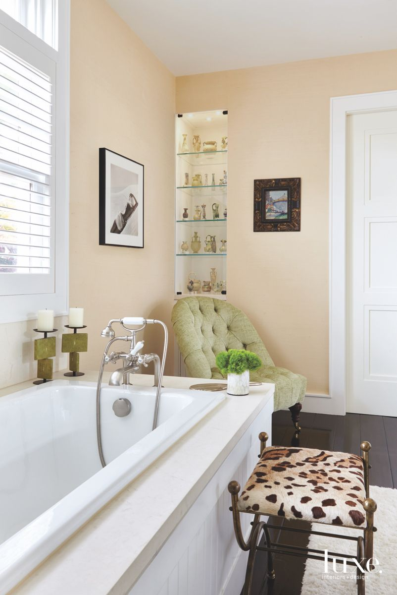 Cream Neutral Master Bathroom with Shelving, Cheetah Print Seat and Vintage Chair