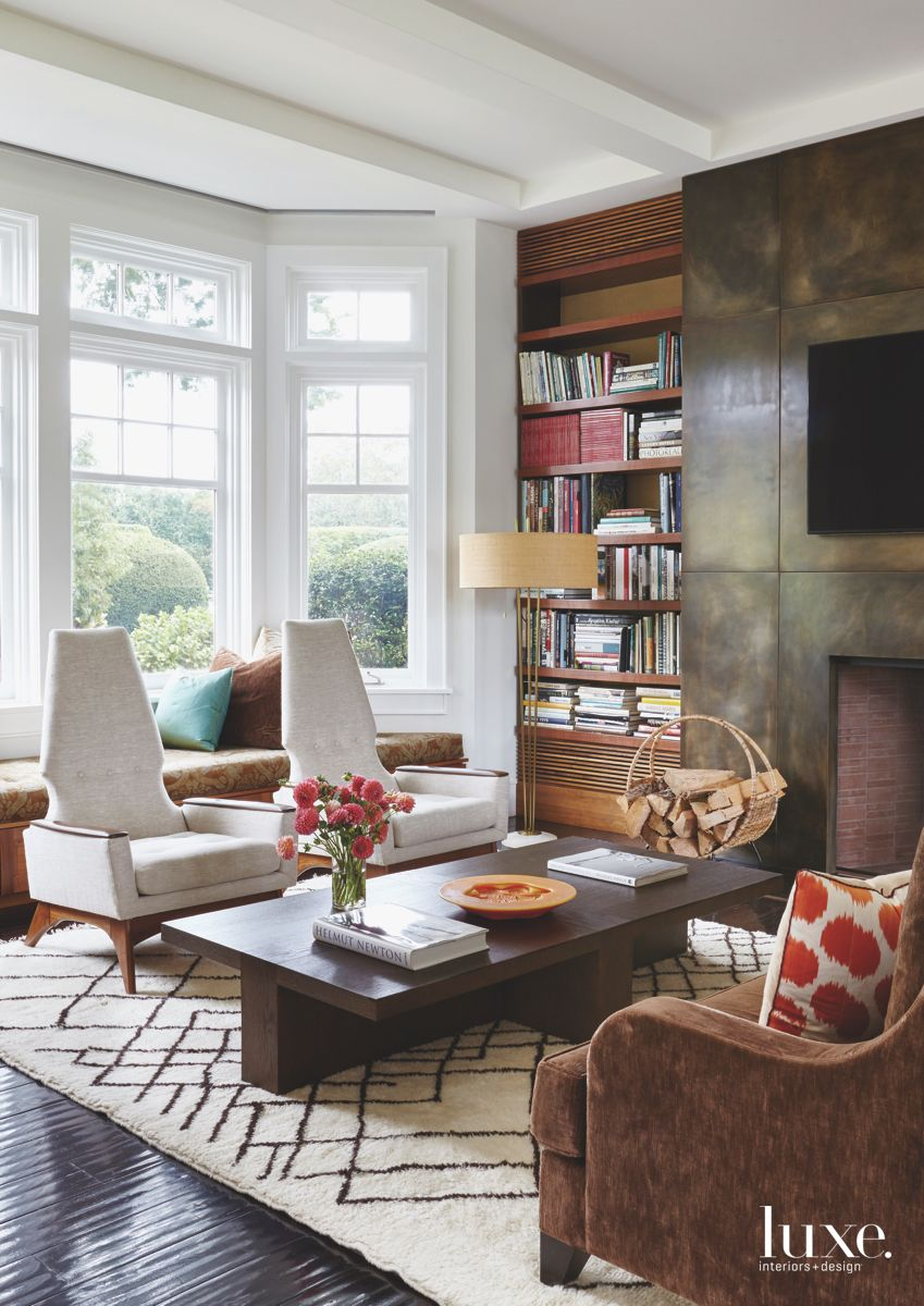 Modern Furniture Library Den with Shelving, Fireplace, and Television