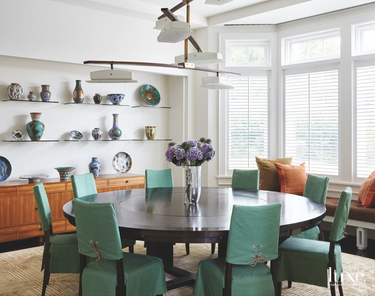 Teal Covered Chair Dining Room with Ceramics Flowers and Window Bench