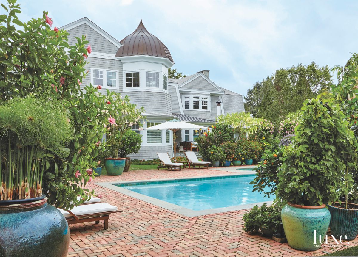 Traditional East End Shingle Home Exterior with Lush Landscaping and Pool
