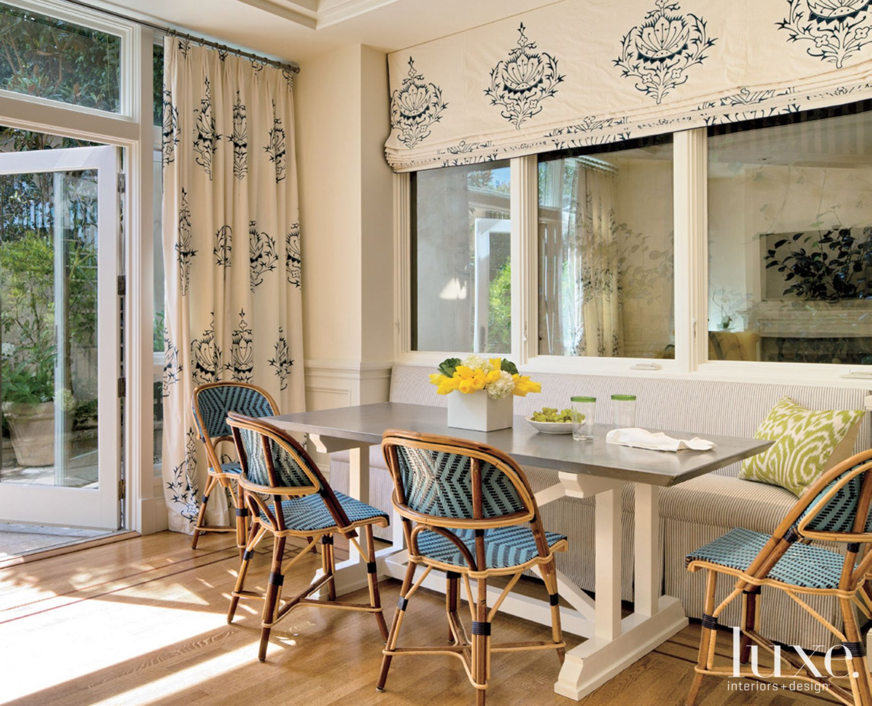 Eclectic White Breakfast Area with Roman Shades