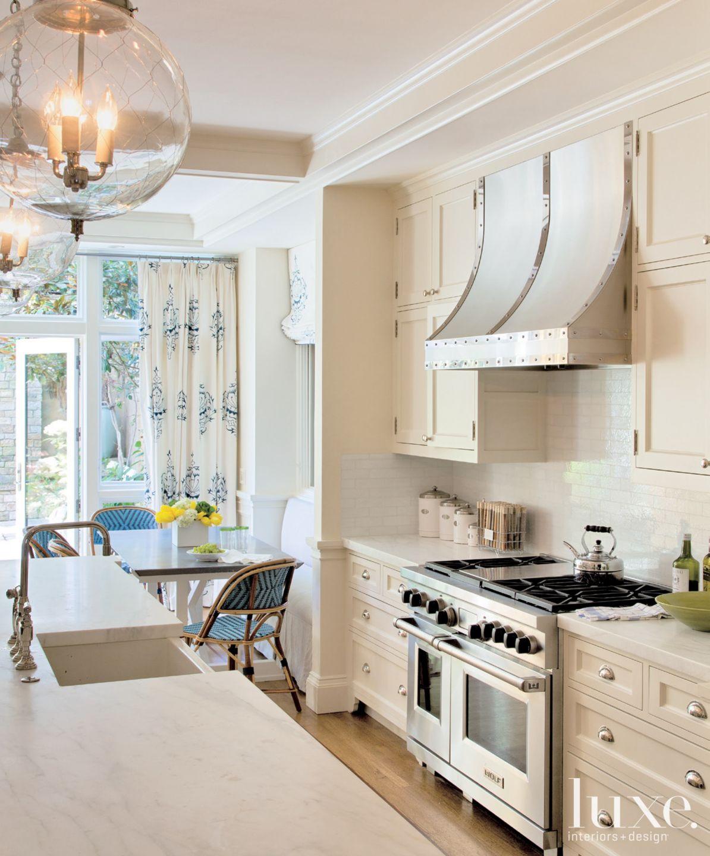 Eclectic White Kitchen Detail with Tiled Backsplash