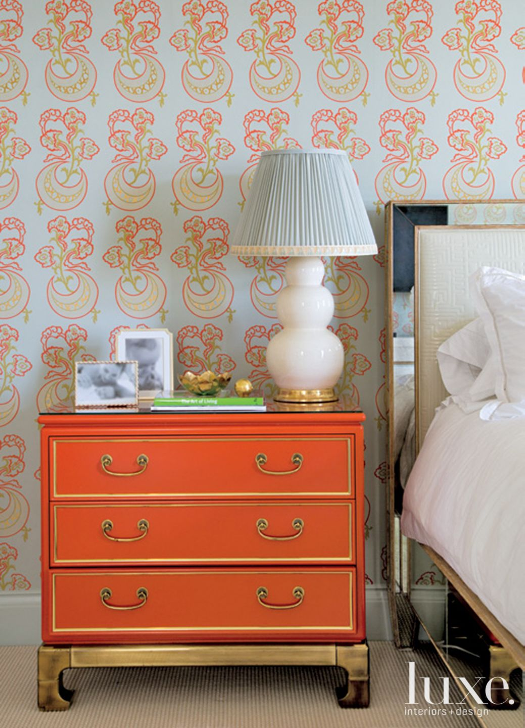 Eclectic Multicolored Bedroom Detail with Orange Dresser