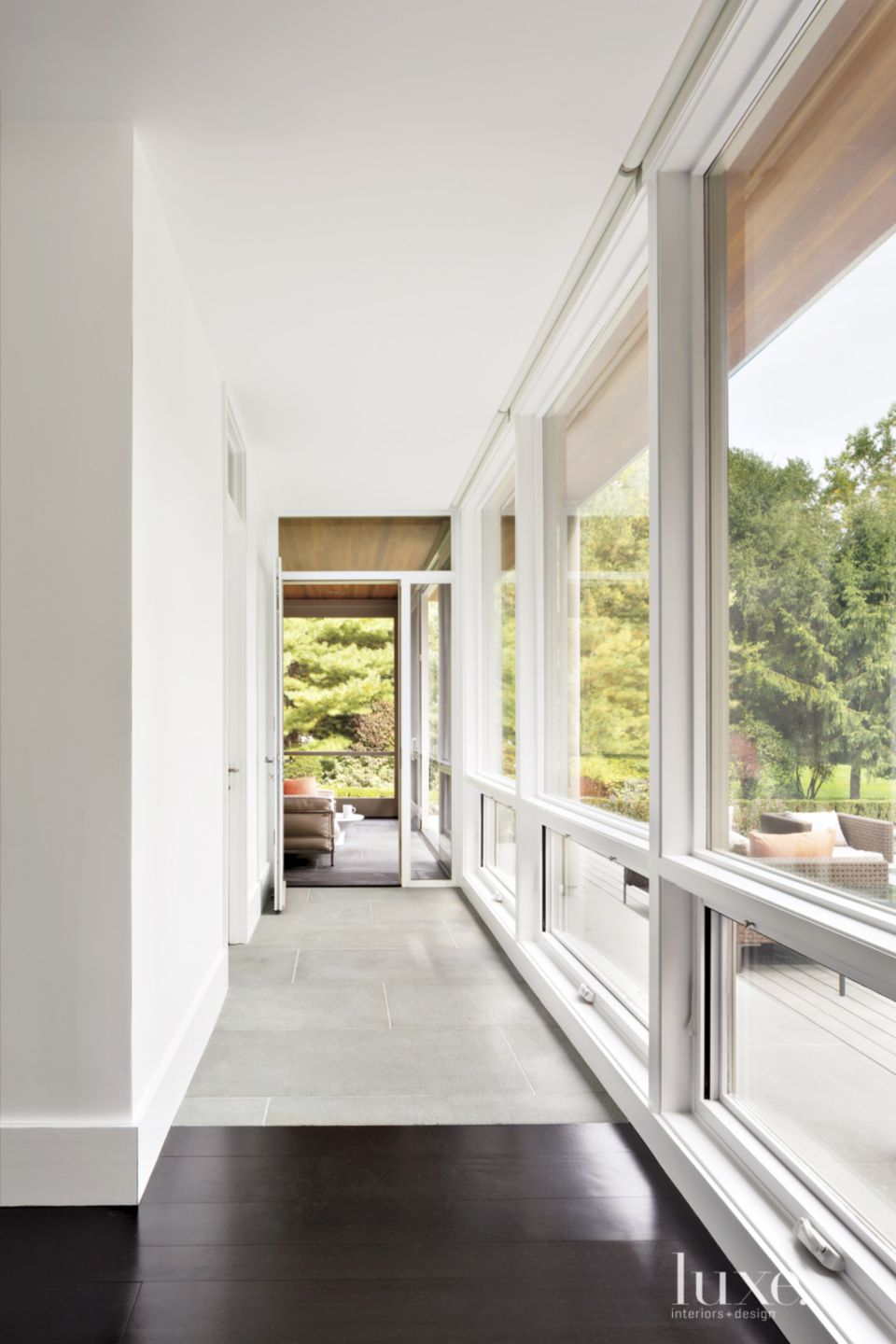 Transitional White Hall with Bluestone Pavers