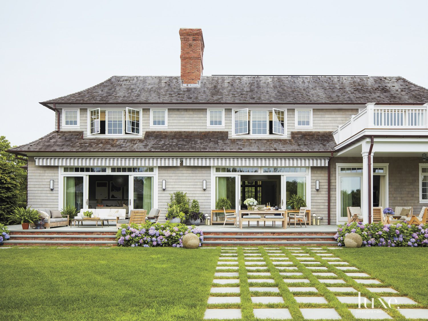 Transitional Shingle Exterior with Outdoor Seating Areas