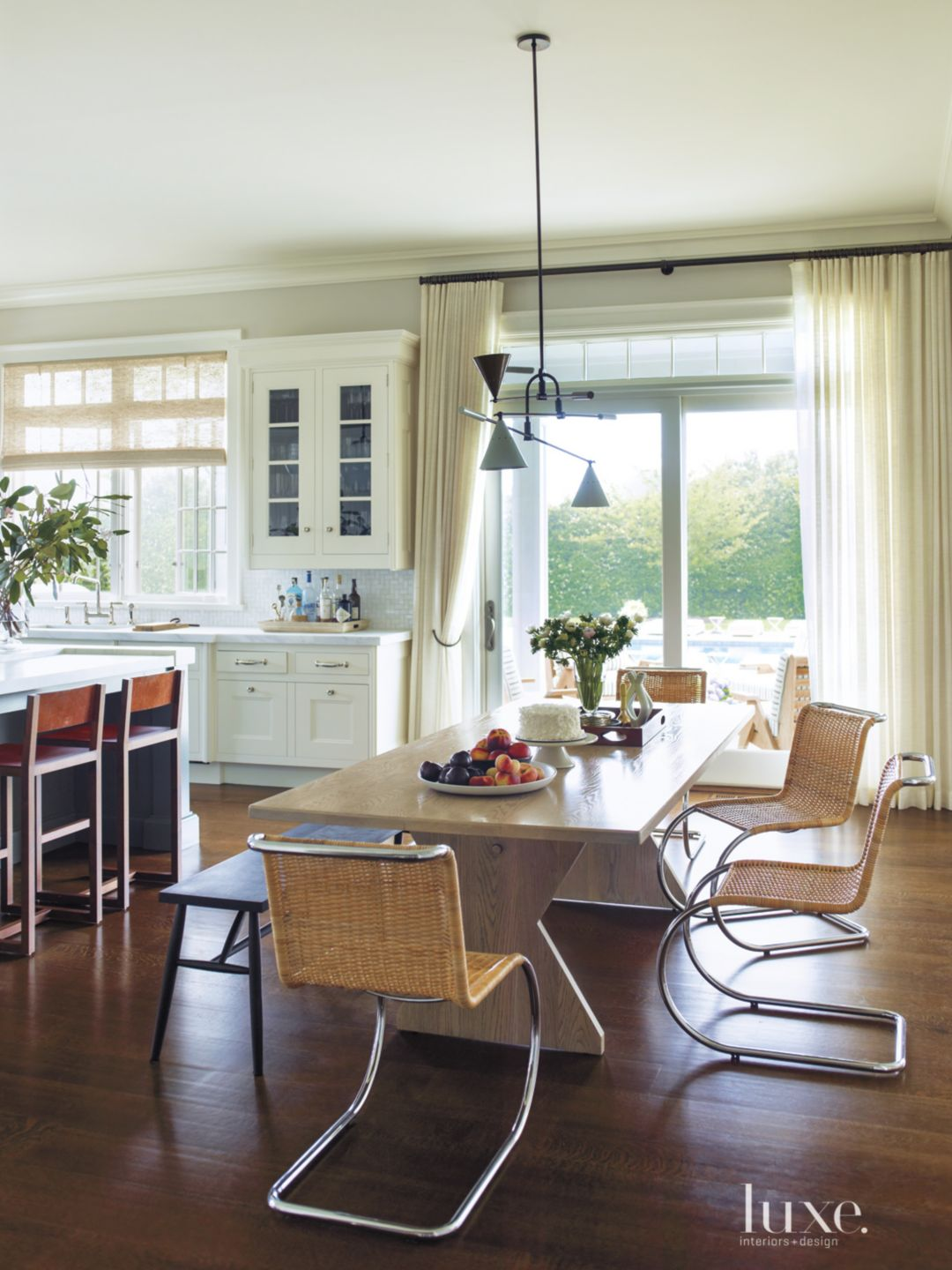 Contemporary White Dining Area with Wicker Chairs