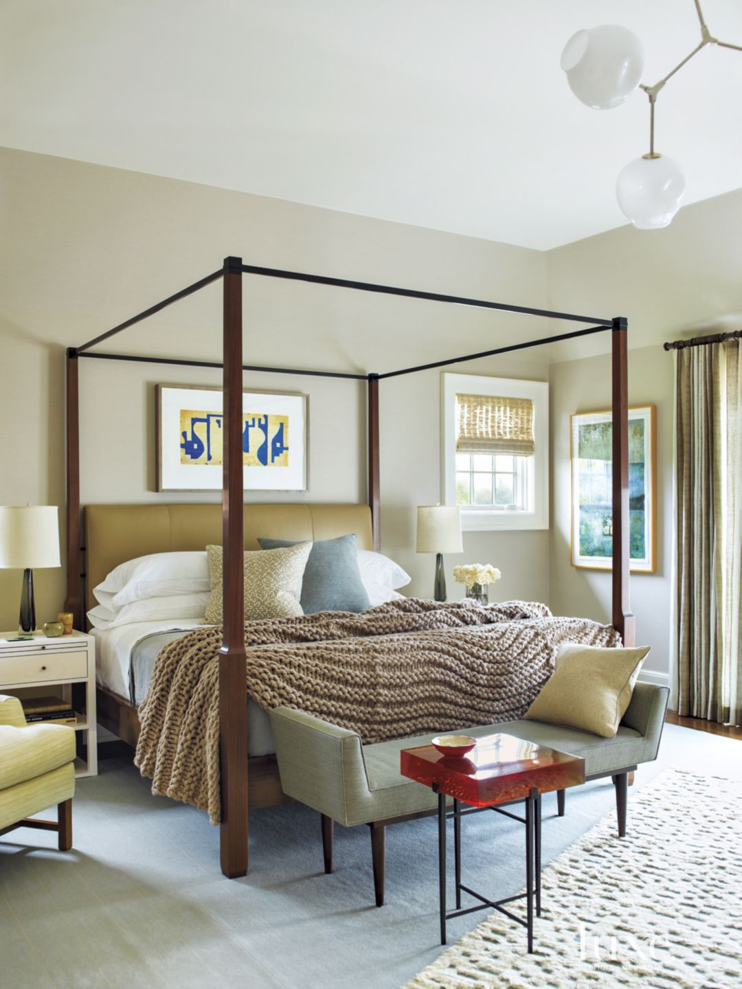 Eclectic Beige Bedroom with Lucite-Topped Table