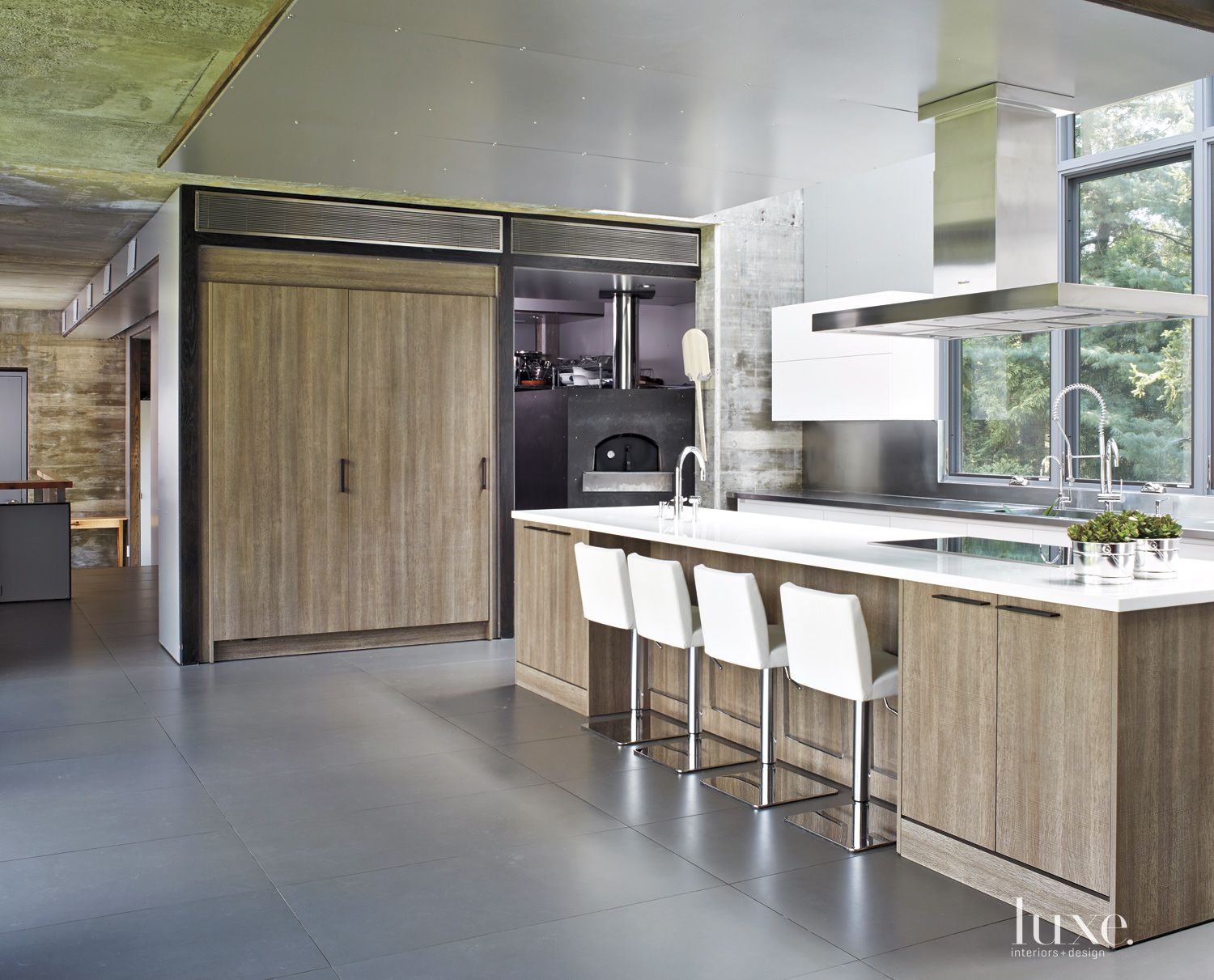 Modern Neutral Kitchen with Corian Countertops