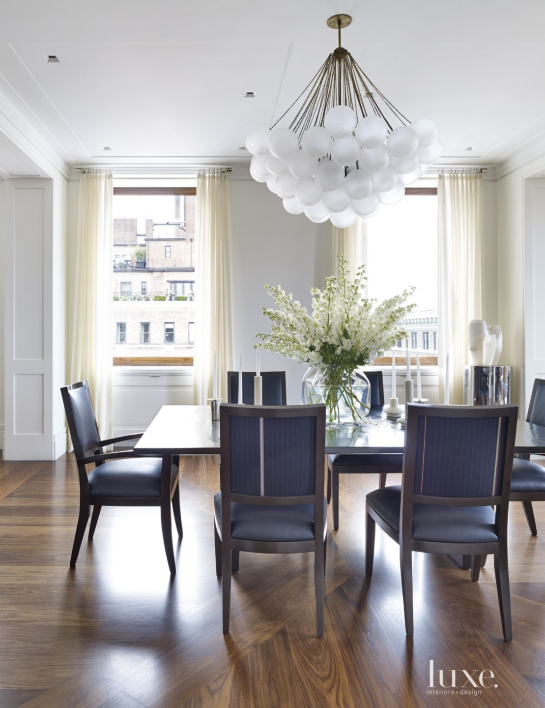 Modern Neutral Dining Room with Cloud Chandelier