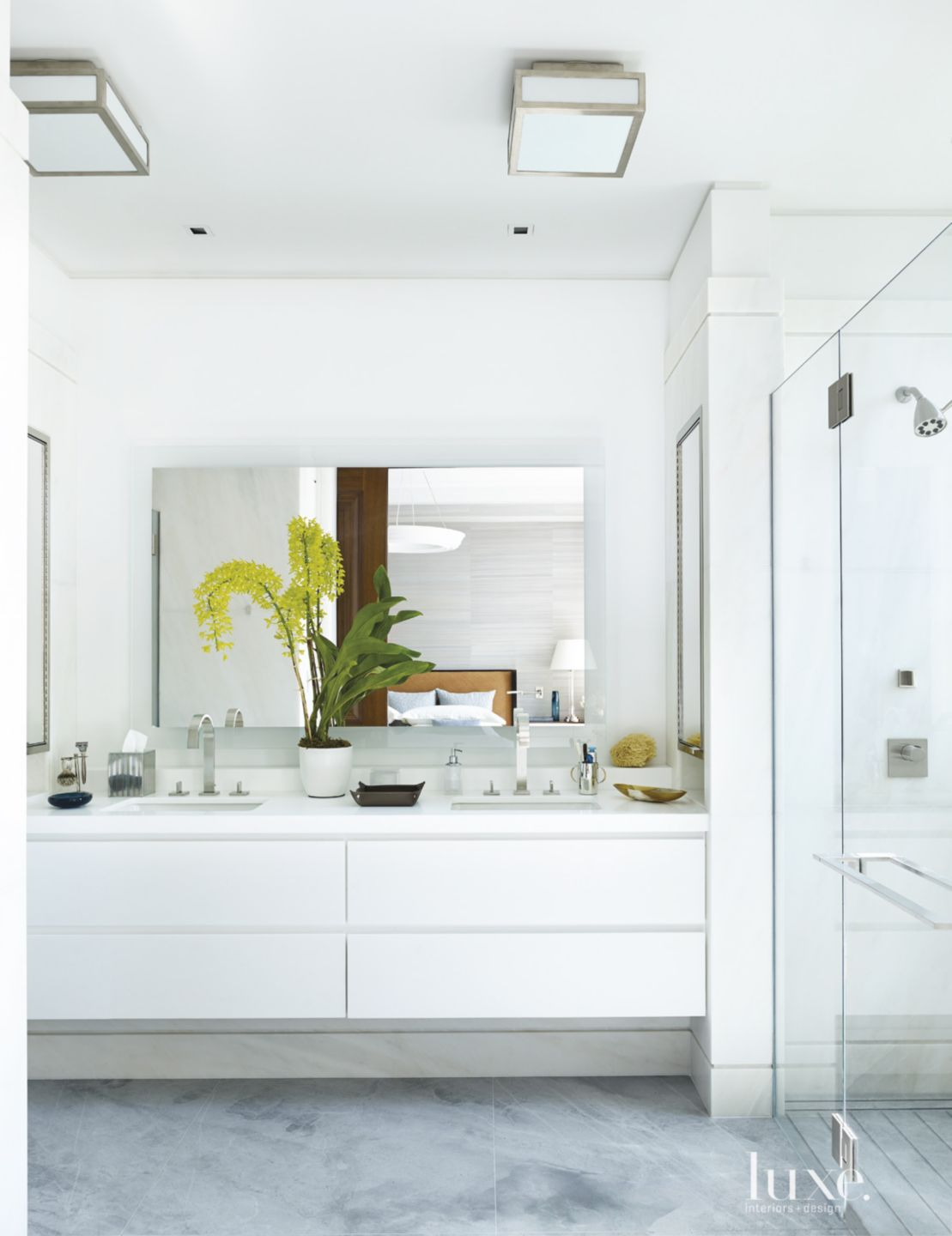 Modern White Bathroom with Marble Vanities