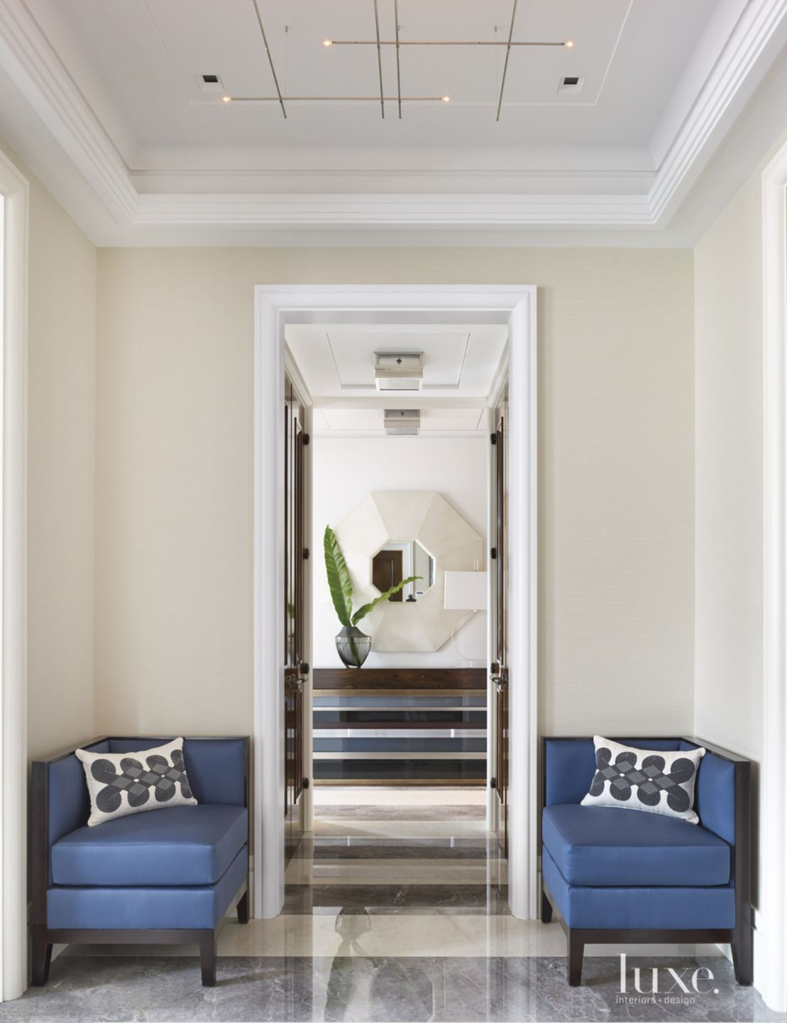 Modern Neutral Foyer with Blue Corner Seats