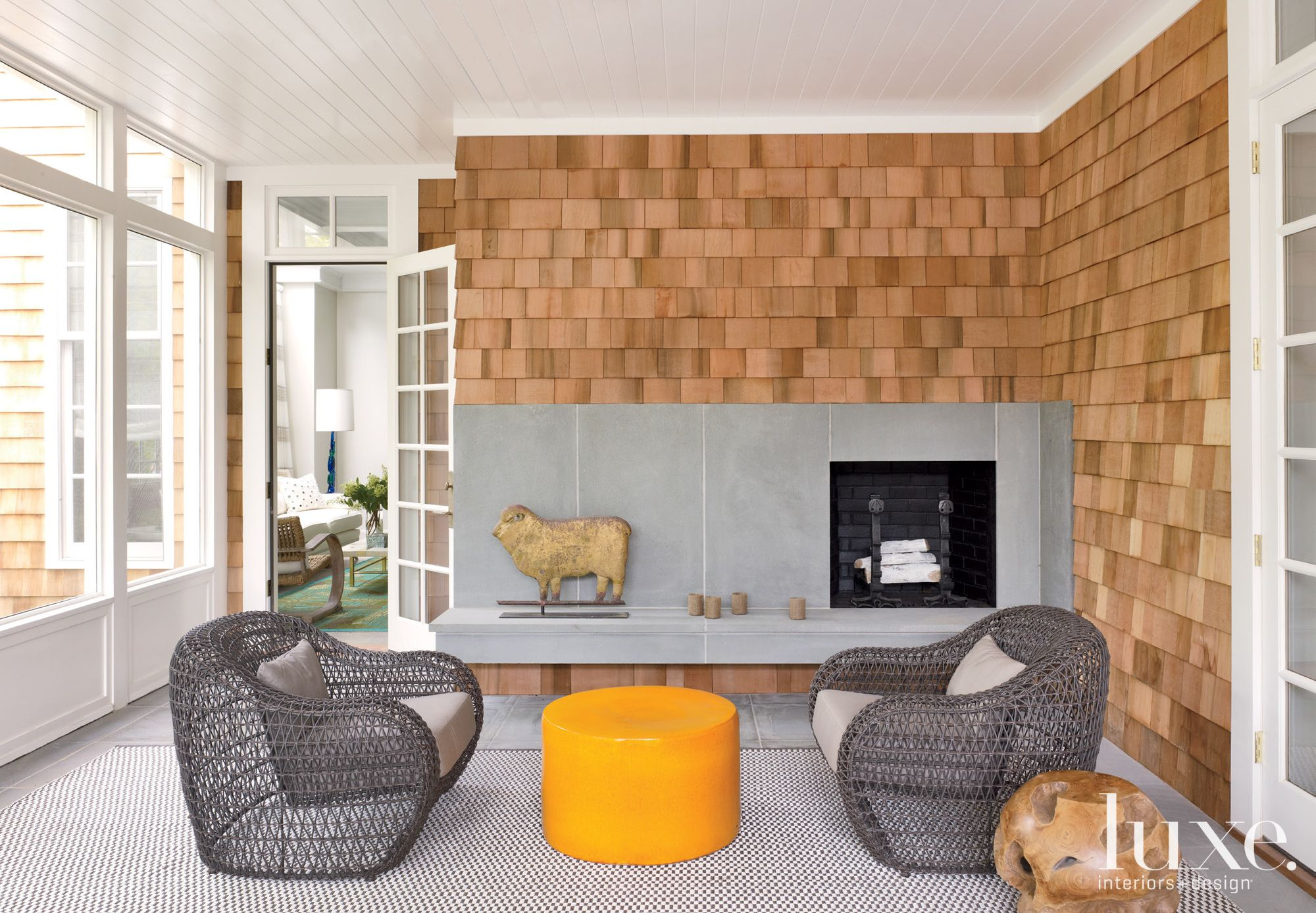 Brown Eclectic Porch with Neon Ottoman