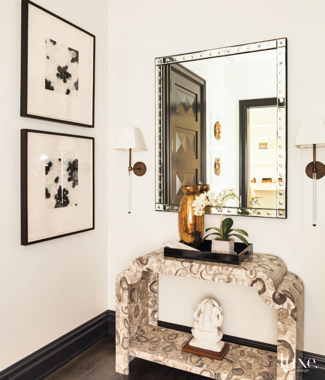Eclectic White Foyer with Beveled Mirror